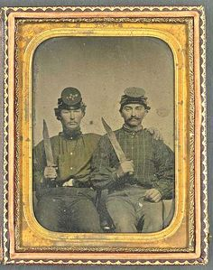 Brothers Private Thomas D. Hilliard and Colonel John Hilliard of Co. C, 12th North Carolina Infantry Regiment, in uniform with Bowie knives