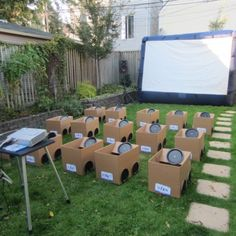 Backyard drive-in movie with cardboard boxes as cars. Great idea for a kids birthday party! Love it.