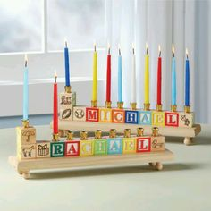 A sweet tradition to start in your family...get each little one their very own Menorah at age 3 so they can begin lighting their OWN each holiday.  We love this alphabet block personalized menorah for the younger set! #DreidelJams
