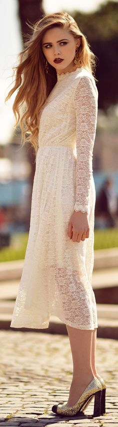 A white lace dress and glitter pumps.