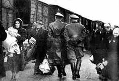 Jews of the Lodz Ghetto at Marysin Station beginning their last journey to Chelmno extermination camp.