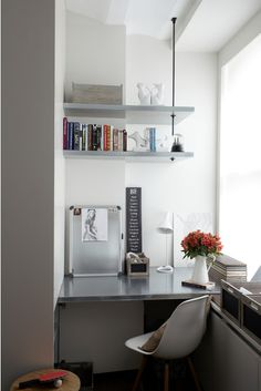 If your tiny home office has limited room for shelving, try carrying the shelves out past a wall and using a metal suspension rod from the ceiling for extra support.