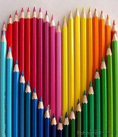 We love to color! Rainbow colored pencils... shaped in heart.