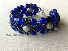 Bracelet is made using deep blue crackled glass beads, accented with factured grey/silver colored pearly beads and dark metal seed beads.