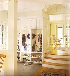 Mud room and steps leading to a light, bright room.