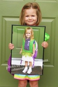 Take a picture on their first day of the school year, frame it and then take a picture on their last day of the school year holding the first picture ... I also love the idea of graduation day holding the first day of kindergarten!