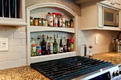 Spice Nook! Add an accent behind your cooktop that is not only interesting but practical!