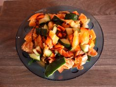 Fantasy salads with carrots, cucumbers, oranges, soja sauce and balsamic vinegar sauce