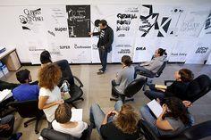 Program in Graphic Design faculty member Michael Worthington leading a critique
