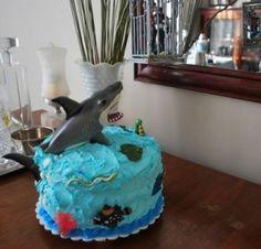 Shark cake with plastic shark.  Cute.