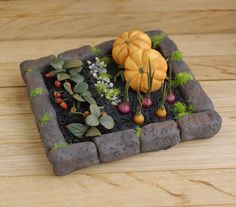 Miniature garden. Garden. Kitchen garden with vegetables. Doll's miniature…
