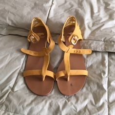Women's yellow suede sandals Beautiful yellow suede sandals. Worn only 1x. Very slight smudge on side of one sandal, hardly noticeable but thought I would mention it Rocketdogs Shoes Sandals