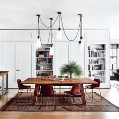 Inside the New York TriBeCa apartment of Naomi Watts and Liev Shreiber. Dining room features Lariat hanging lighting by Apparatus Studio, Sonora Canyon dining table by Ralph Lauren Home, Girón chairs by Sol & Luna, and finished with vintage Tuareg carpet. Architecture and interiors by New York-based design firm, Ashe + Leandro. (Image: Douglas Friedman) #meandmybentley