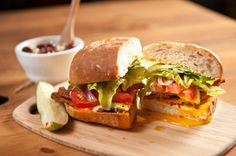 Known for his creative approach to local restaurants, David Bailey crafted a menu of sophisticated bar food for4 Hands Brewing Co. Pictured is one of our sandwich picks: the spicy BLT.