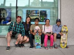 Artists Patrick Thompson, Alexa Hatanaka, Parr Josephie, Alasuak Akesuk and Latch Akesuk sit in front of the Art Gallery of Ontario in Toronto June 28. Behind them, video screens show footage of their group, Embassy of Imagination, and the work behind the group's public murals. Cape Dorset youth will participate in two new mural projects this summer, in Ottawa and in the home community. (PHOTO BY SARAH ROGERS)