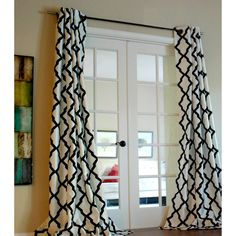 Graphic yet subtle, this Trellis panels offer a touch of a modern statement to your windows. Repetitive black flock patterns on a crisp white textured faux silk style this beautiful piece.