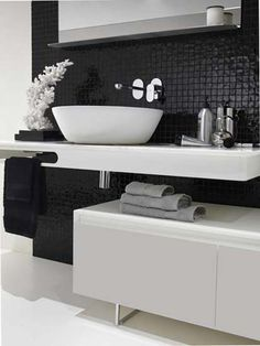 Charcoal black mosaic tiles as backsplash for this contemporary bathroom inspiration.