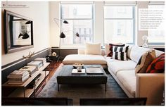 Nina Freudenberger.  Great use of space with a sectional, ottoman, and side chairs.  Comfy space.