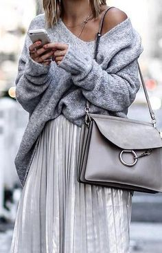 chunky knit jumper. silver pleated skirt.                                                                                                                                                                                 More