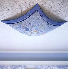 Put scarf over ugly ceiling lights