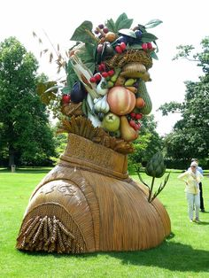 """The Four Seasons"" is a sculpture series of four giant heads, each representing a season of the year. Artist Philip Haas crafted the 15 foot tall sculptures out of fiberglass. The sculptures are inspired by the work of Renaissance painter Giuseppe Arcimboldo who created portraits composed of everyday objects like fruits and books"