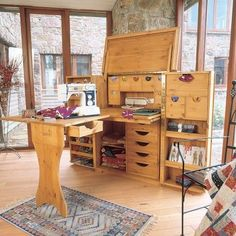 Wow! Fantastic cabinet that folds out into an entire sewing space! #sewing #organize