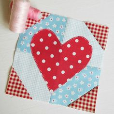 The Splendid Sampler Block 1 - Hearts Aflutter. A easy patchwork/applique block starts this sew-along. Designed by Pat Sloan.