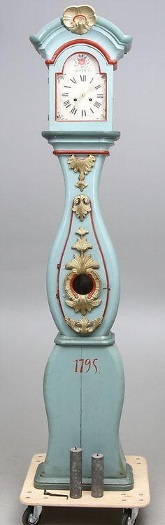 Old Mora clock, richly ornamented. Folk art rococo, 18th century.