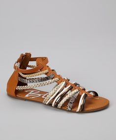 Laid-back+days+call+for+a+shoe+that's+comfy+and+carefree.+Boasting+a+breezy+design+with+beautifully+braided+straps+and+sassy+snakeskin+accents,+this+easygoing+sandal+is+a+must-have+for+sunny-weather+style.