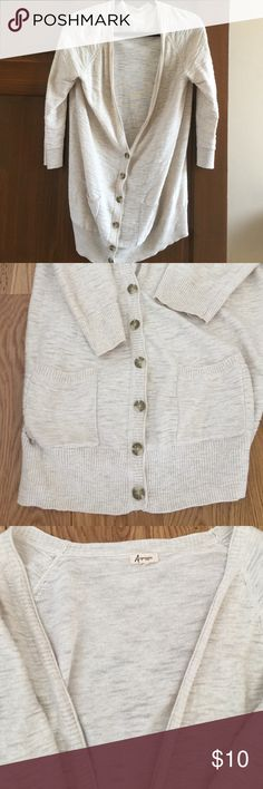 """Button Front Cardigan by Arpeggio Cream Colored button front cardigan by Arpeggio. 2 front pockets, hits below the hips, 3/4 sleeves and V-Neck. Great for transitional Spring and Fall months and perfect for pairing with leggings and boots.  No size but fits like a Medium. 30"""" length. Arpeggio Sweaters Cardigans"""