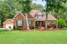 312 Arrow Point Lane, Davidson NC PRICED BELOW APPRAISAL VALUE! Immaculate full brick home on almost an acre in Davidson. Loaded with upgrades! First-floor master suite and laundry room. Oversized 2-car garage plus 832 sq. ft. detached garage.