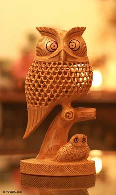 Feathery details embody the wisdom the owl in this original sculpture. Carved by hand from kadam wood, the piece is sculpted in classic jali or openwork, with a tiny owl inside the latticed body. Wood Owls, Chip Carving, Buy Wood, Wooden Art, Whittling, Decoration Table, Wood Sculpture, Wood Turning, Hand Carved