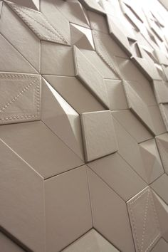 Leather clad diamond tiles with geometric and embossed pattern, game of light and shadows with a smooth surface