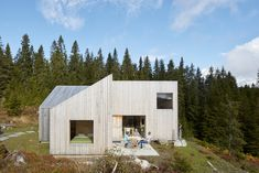 Exterior, House Building Type, Wood Siding Material, Gable RoofLine, Shed RoofLine, Flat RoofLine, and Cabin Building Type The pinwheel plan also led to the creation of two sheltered outdoor spaces: the morning porch and the evening porch. Photo 3 of 14 in A Pinwheel-Shaped Cabin in Norway Is a Fresh Take on the Traditional Hytte