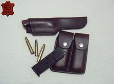 Bainha feita sob medida para a faca Hilton Padilha (80 anos) e porta munição para a Colt 45. Confeccionada em soleta natural, tingida e costurada a mão.