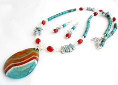 "COLOR ME ""ECLECTIC"" NECKLACE AND EARRINGS SET! This lovely set is truly a wonderful ""eclectic"" mix...al flowing together beautifully! The set is chock full of Vintage Swarovski crystals, nice quality howlite turquoise tube beads, freshwater stick pearls, petite moonstone rondelles, burnt sienna tagua nut beads, 3X2mm silver plated rondelle beads, and sterling silver jump rings. The necklace is 26 inches long, is adorned with a beautiful, onyx agate druzy pendant, which is attached with a…"
