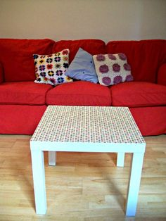 Nasty black ikea coffee table, painted white and covered with Orla Kiely wallpaper - tutorial on blog :)