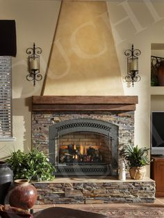 I like the colors of the stone, and our fireplace will look somewhat similar to this one. I don't care for what they did above the fireplace. Fireplace Design, Pictures, Remodel, Decor and Ideas - page 242