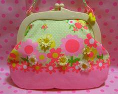 プラフレームがまぐちのバッグです。お花模様に造花をところどころ縫い付けてあります。|ハンドメイド、手作り、手仕事品の通販・販売・購入ならCreema。