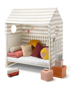 Stokke Home toddler bed tent. Round windows for a view and roomy pockets to store favorite toys. Neutral stripe pattern to compliment a myriad of nursery styles. OEKO-TEX Standard 100 class 1. Polyest