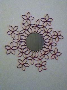 Toilet paper roll mirror.