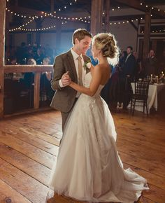 Bride & groom's first dance // Lauren Fair photography // http://blog.theknot.com/2013/12/16/a-cozy-and-glitzy-winter-wedding/