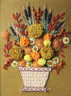 fall bouquet. Stitched this same kit in 1970. Hangs in my playroom. Great ex of 1960's-70's kitsch.