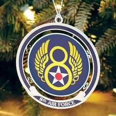 8th Air Force Christmas Ornament/Keepsake Stunning Presentation Custom designed by Sporty's and available exclusively from us, these striking Ornaments are crafted from stamped metal to honor American military aviation. The 8th Air Force Ornament showcases the familiar insignia of The Mighty Eighth created during WWII from 1944-1945. Beneath each design is a scroll with the description.