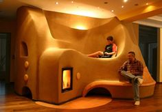 Too cool not to pin! Rocket stove heater built into cob furniture/seating that…
