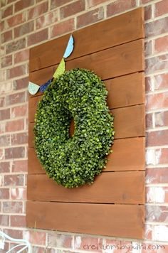 A wooden sign to hang a boxwood wreath is easy to make, but makes a big impact.