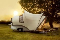 French company Beauer is offering a solution in their 3X caravan, which is tiny on the road, but expands to three times the size when it's parked for the night.