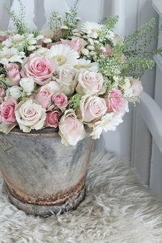 Flowers in shabby bucket