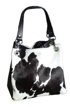 This gorgeous Camilla Black & White Cowhide Bag it´s made by Ella Maiden Australia . The bag is a larger style bucket bag designed for everyday use. SHOP :: Camilla Black & White Cowhide Bag - COUNTRY CULTURE