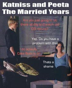 Katniss and Peeta: The married years. She's obviously wearing the pants Peeta